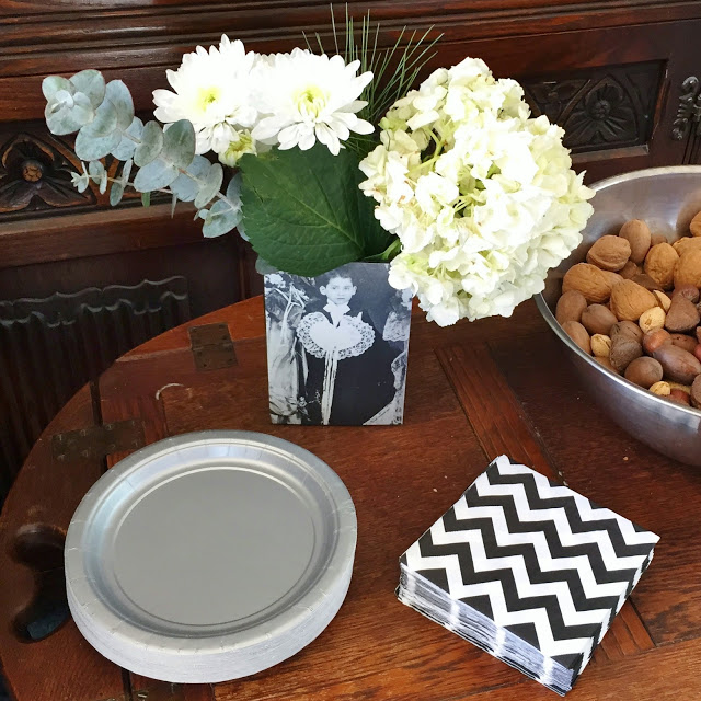 To Carry Our 70th Birthday Theme Ideas We Used Gray Plates And Utensils Along With Chevron Pattern Napkins Cups
