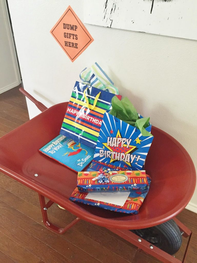 construction birthday party ideas: use a wheelbarrow to collect gifts