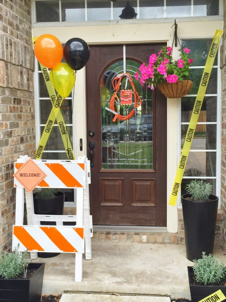 construction birthday party decor using a real construction barricade