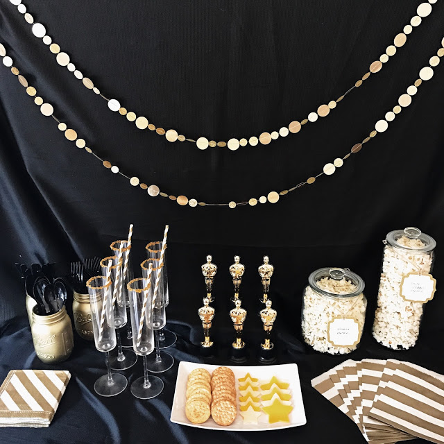 hollywood theme party decorations: black backdrop with gold garlands