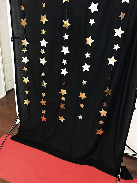 photo backdrop and red carpet for planning an oscar party