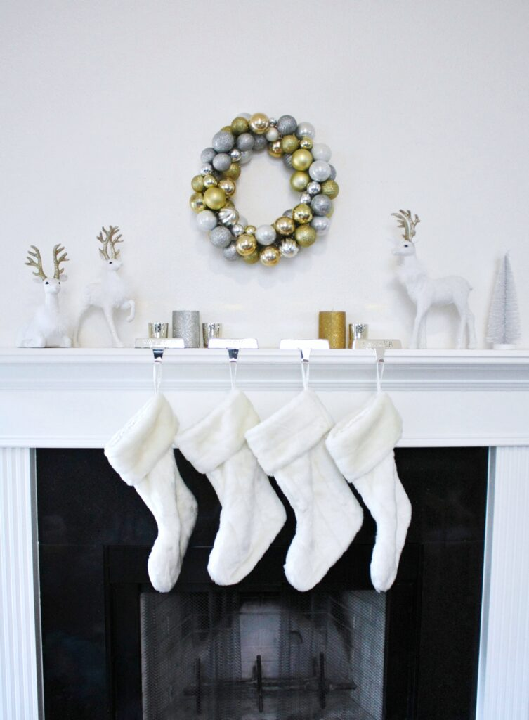minimalist white silver gold christmas mantel with a DIY silver and gold Christmas wreath