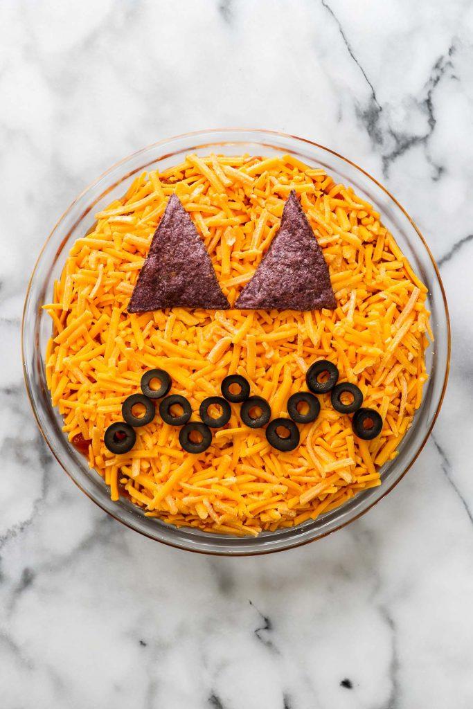 kid friendly halloween party food - jack-o-lantern layered dip
