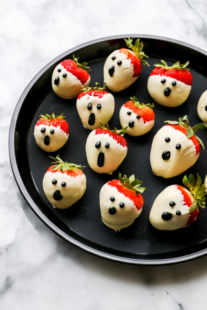 kid friendly halloween party food - chocolate dipped strawberry ghosts