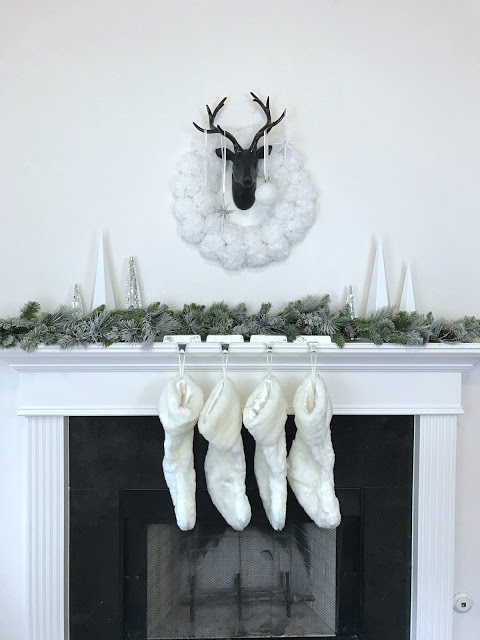 Black white and silver modern Christmas mantel