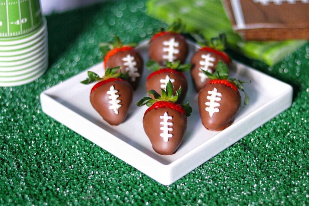 football party food idea: chocolate covered strawberry footballs