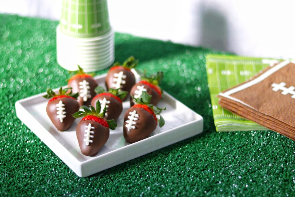 chocolate covered strawberry footballs for a last minute football party food idea