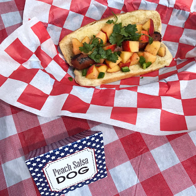 hot dog bar toppings: peach salsa dog