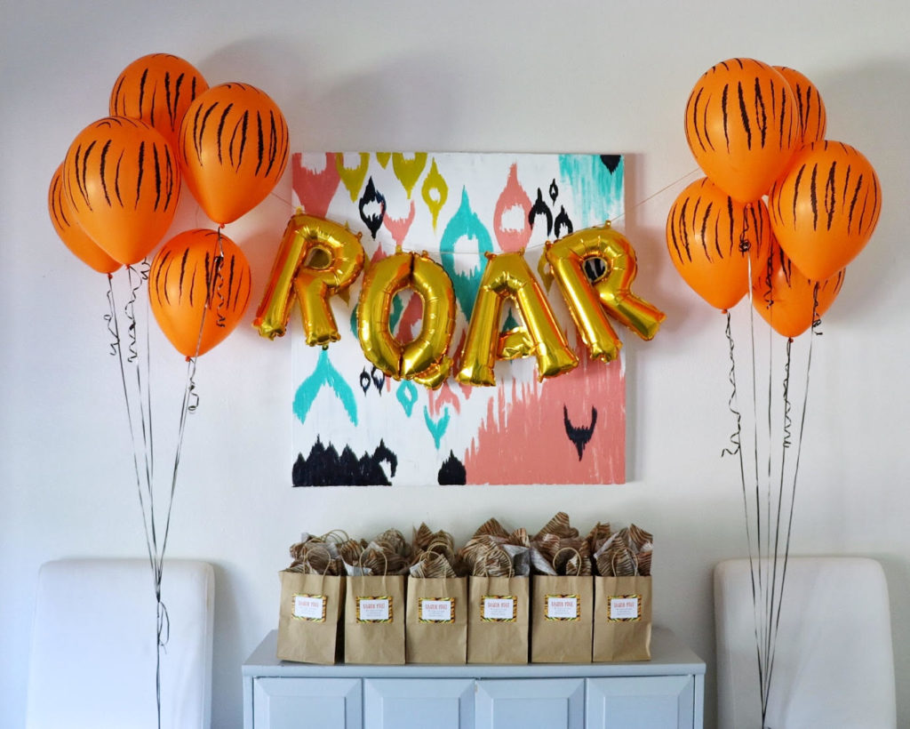 tiger themed party decor ideas using balloons and ROAR lettering