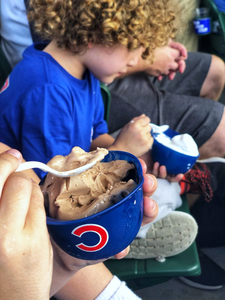 kid-friendly food at wrigley field for a chicago cubs game - soft serve ice cream served in mini souvenir hat bowls