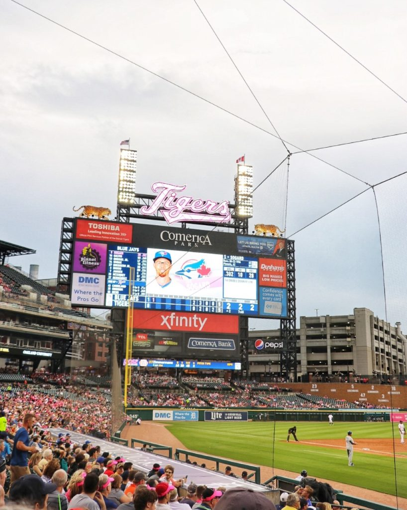 comerica park scoreboard with two tiger statues on top