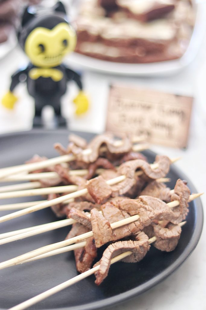 Food ideas for a Bendy and the Ink Machine themed birthday party: Butcher Gang beef satay skewers
