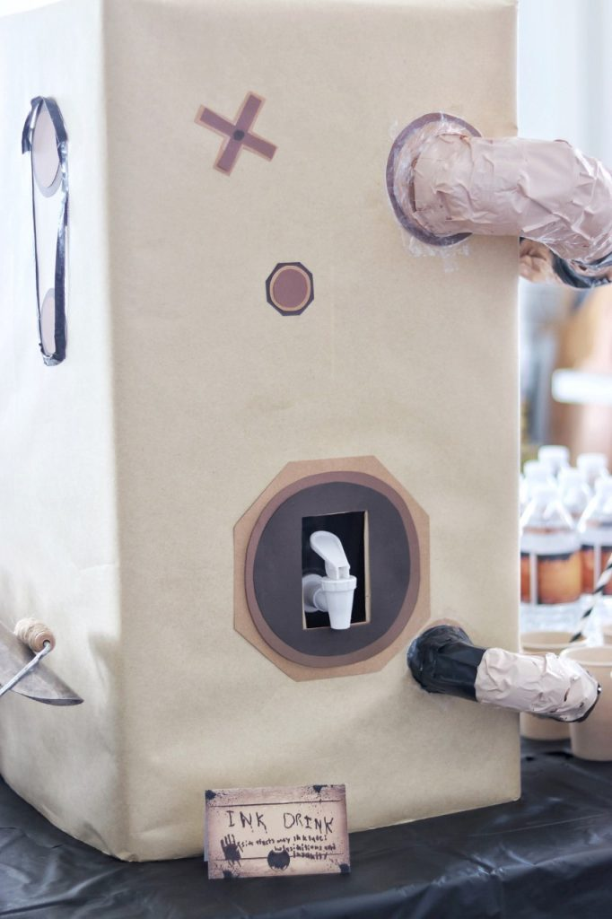Bendy and the Ink Machine party decorations: DIY cardboard ink machine for a drink dispenser.