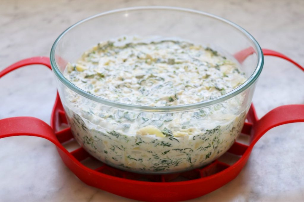 Instant Pot Feta, Spinach, and Artichoke Dip recipe on a bakeware sling