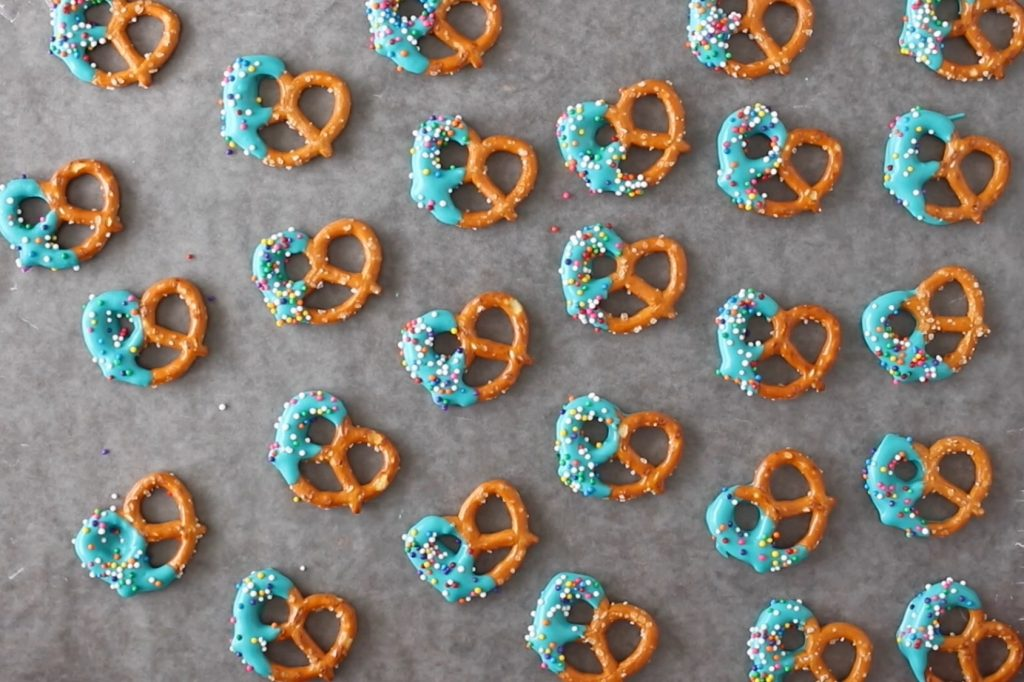 pretzels dipped in candy melts for a party favor idea