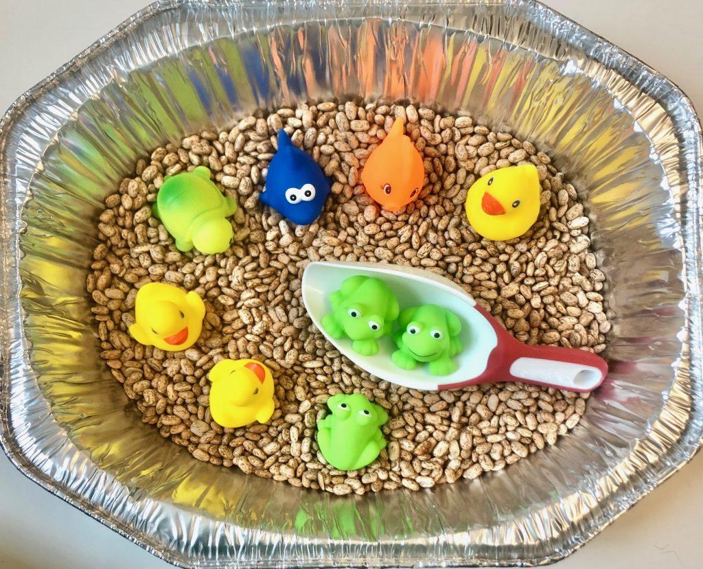 dollar store sensory bins: Bath Toys and Beans
