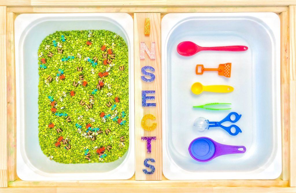spring sensory table ideas: insect sensory bin for toddlers