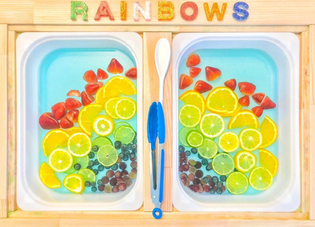 water sensory bin ideas: fruit rainbow sensory bin