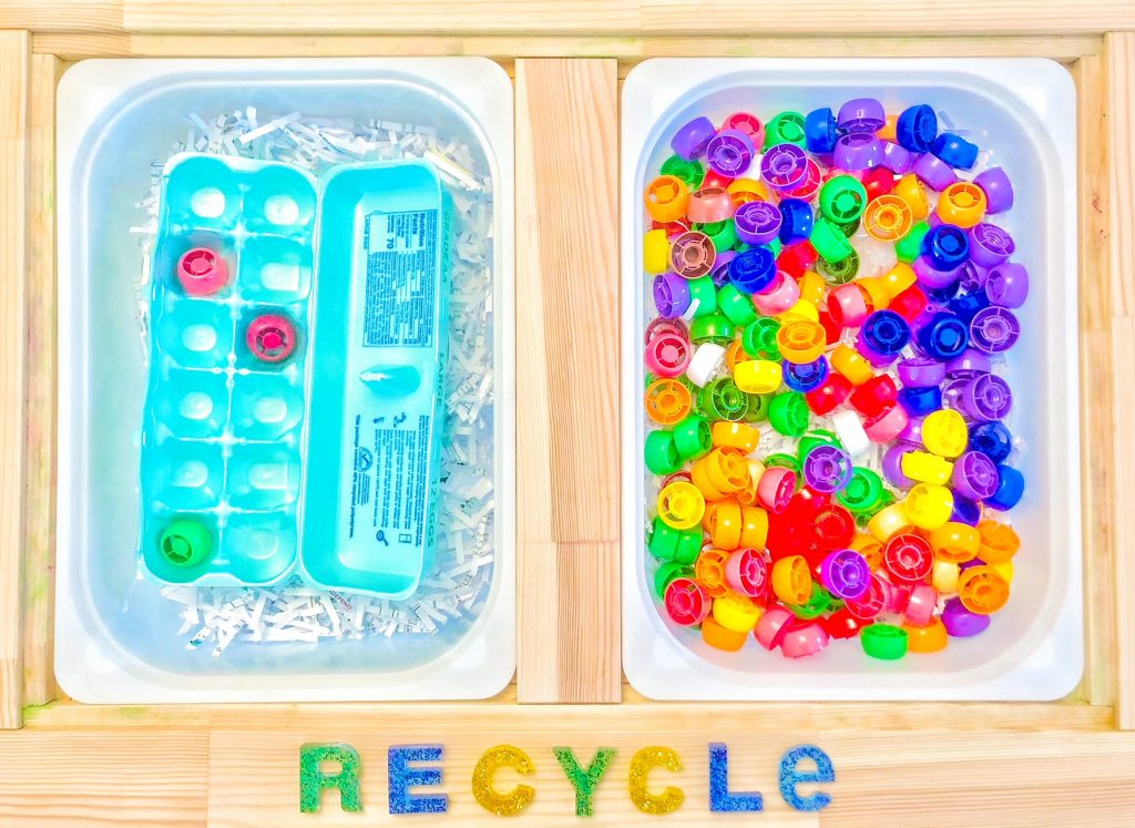 recycling themed sensory bin